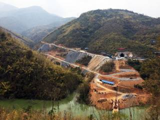 Tunnel portal under construction for China-Laos Railway. By Ashley Scott Kelly, 2018.